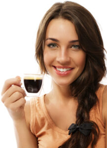 woman-smiling-with-a-tiny-cup-of-coffee